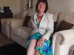 Chubby grandma models her sexy stockings and panties for us porn tube video