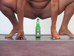 Fucking a Beer bottle tube porn video