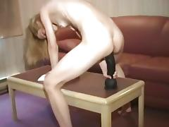 Skinny blonde amateur bouncing on a huge dildo