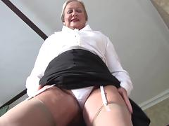 Beautiful matured granny in nylon stockings stripteasing seductively indoors