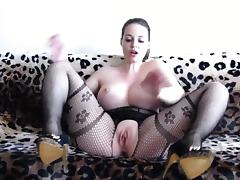 Hot woman wearing a black bodystocking plays porn tube video