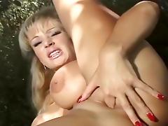 Busty MILF Tanya Does Herself In Yard