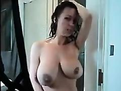She discovers the hidden camera and plays with her body
