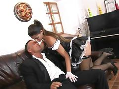 Stunning maid passionately rides the big dick on a leather couch