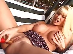 Blonde Lounges on Porch Masturbates