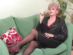 Kinky mature tart smokes a cigarette and fingers her twat porn tube video