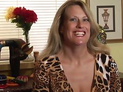 Daphne makes a telephone call while fingering her shaved beaver
