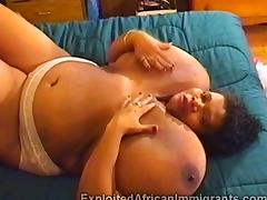 African BBW with massive balloon tits masturbates in