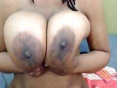 Kelly: black busty babe doing dildo titfuck