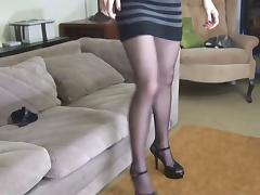 Sexy brunette puts on sheer black stockings on her toned legs porn tube video