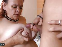 Busty granny sucking cock