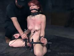 Blindfolded redhead tortured in a new way in the BDSM dungeon
