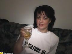 Sexy Dutch cougar decides to masturbate with a bottle of Serbian beer porn tube video
