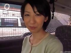 Kinky Japanese model getting attacked with a vibrator on the back seat