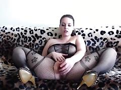 Hot woman wearing a black bodystocking plays