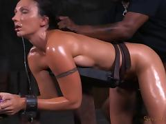 Saucy raven-haired bint gets restrained and banged with a thick rod