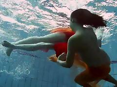 Brunette lesbain teen with natural tits enjoying pool