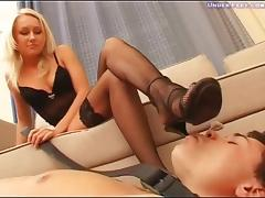 Naughty blonde has her shoes and her feet licked by a horny dude