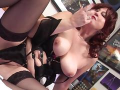 Mature redhead bitch has some fun with a long dildo