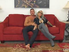 Raunchy blonde with perfect boobs gets bonked on the red couch tube porn video