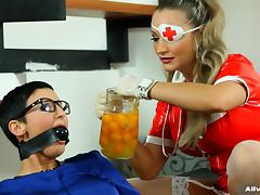 Latex nurse pours thick yellow goo on a babe in a blouse porn tube video