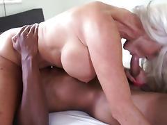 Busty granny enjoys riding hard on a massive black shaft porn tube video
