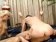 Two raunchy bitches enjoy sharing a throbbing meat pole tube porn video