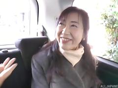 Horny MILF from Japan allows the dude to play with her twat