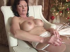 Sexy matured granny widening her legs when masturbating