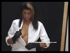 Busty babe gets naked and puts on sexy lingerie and gloves tube porn video