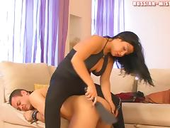 Classy hypnotized Russian femdom dame love spanking her guy while her toes are licked in a cozy room