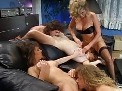 Retro shoot of cowgirl coping with pussy fisting in group sex porn tube video