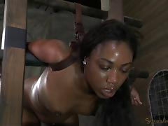 Black babe surrounded with hard dicks in the secret sex dungeon