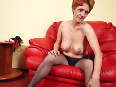 Big tits mature damsel inserting massive toy in pussy