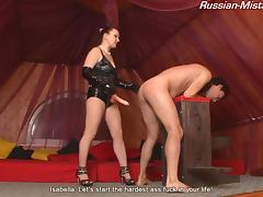 Mistress Isabella is once again punishing her slave with a strap-on
