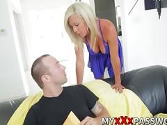Busty blonde MILF gives an awesome blowjob on a sofa porn tube video