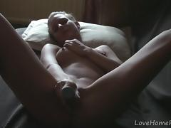 Exquisite girl uses her toy and enjoys it