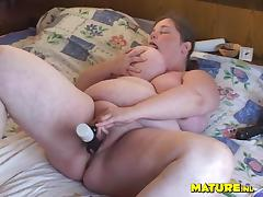 Mature Dutch babe with huge curves finally decides to use a black toy tube porn video