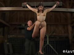 Classy hot ass brunette in bondage coping up with BDSM torture