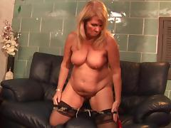 Chubby mature slut Lisa plays around with a red dildo