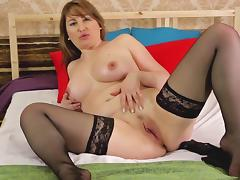 Cougar in nylon stockings getting cozy before fingering her pussy