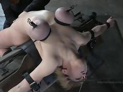 Short-haired blonde with round hooters getting tortured in basement tube porn video
