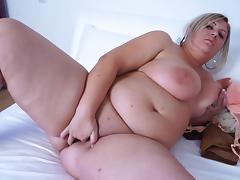 Fat blonde tart strips down and masturbates on the bed porn tube video