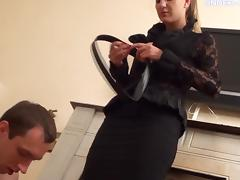 Foxy blonde domina Jennifer has her shoes licked by a horny stallion