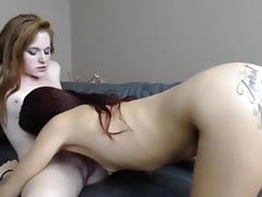Hot redhead and her friend suck each other's pussies