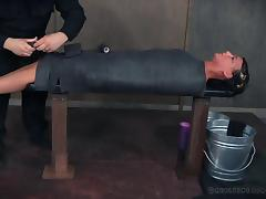 Curvy brunette with natural tits tied on desk in BDSM torture