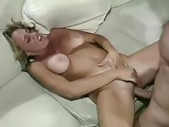 Cute Blonde Teases Her Guy with a Strip Dance