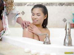 Phoenix Marie going lesbian with an Asian babe in the bathroom tube porn video