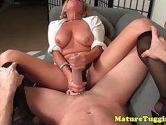 Busty milf stroking cock