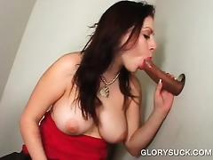 Dirty and busty slut sucking dick on gloryhole